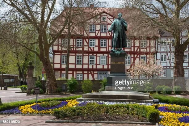 Linggdenkmal statue of Lingg von Linggenfeld at Linggplatz with half-timbered houses behind, Bad Hersfeld, Hesse, Germany