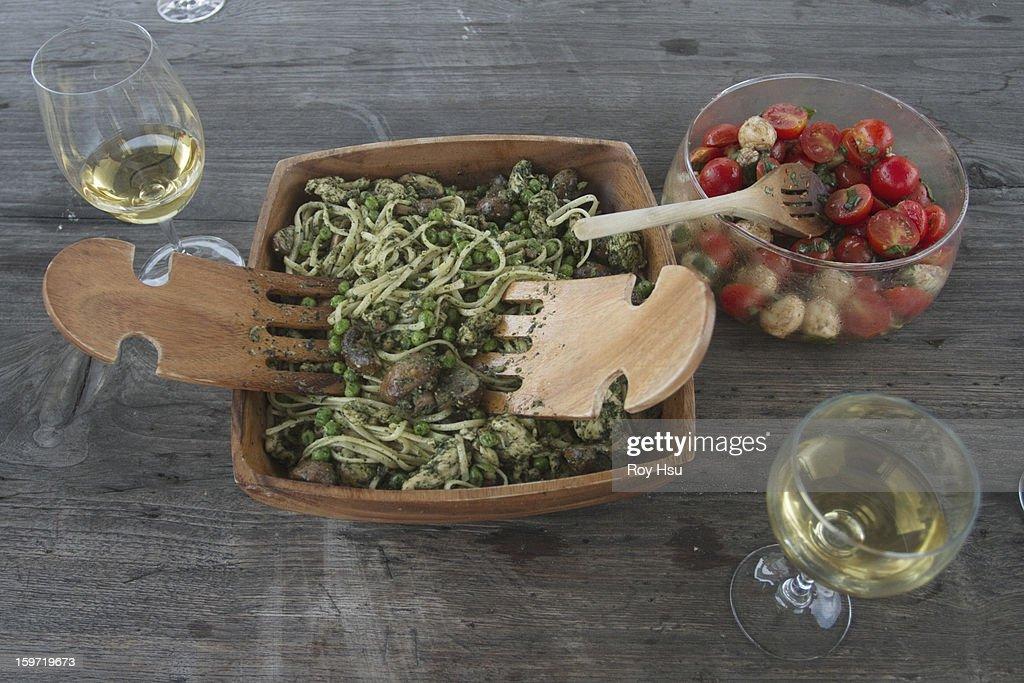 Linguine with pesto, wine and caprese salad : Stock Photo