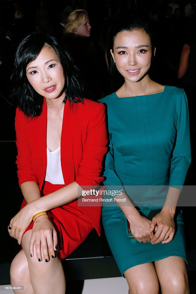 Linh Dan Pham and Yao Xing Tong attend the Elie Saab show as part of the Paris Fashion Week Womenswear Spring/Summer 2014, held at Espace Ephemere Tuileries on September 30, 2013 in Paris, France.