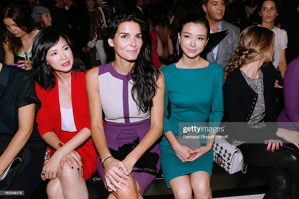 Linh-Dan Pham, actress Angie Harmon and Yao Xingtong attend the Elie Saab show as part of the Paris Fashion Week Womenswear Spring/Summer 2014, held at Espace Ephemere Tuileries on September 30, 2013 in Paris, France.