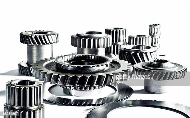 Linked steel cogs on white background