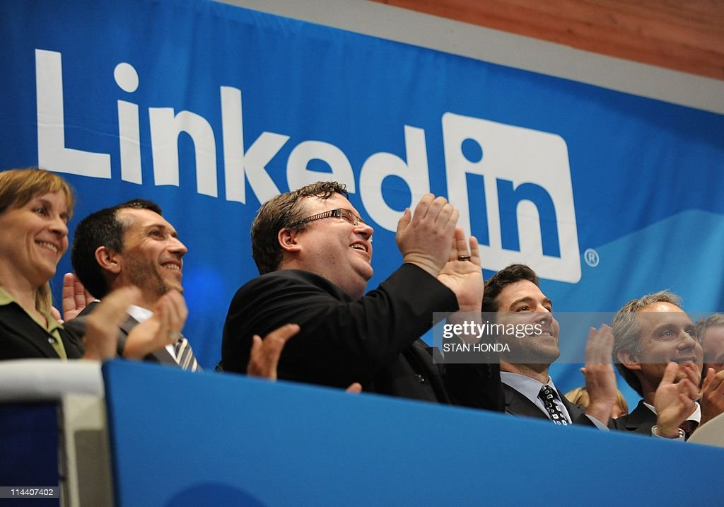 Linkedin founder Reid Garrett Hoffman (C) and CEO Jeff Weiner (2nd R) at the ringing of the opening bell of the New York Stock Exchange May 19, 2011 during the initial public offering of the company. AFP PHOTO/Stan HONDA