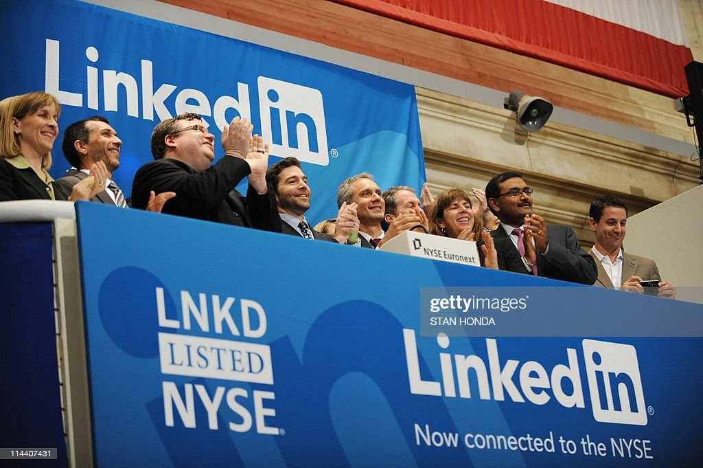 Linkedin founder Reid Garrett Hoffman (Center with beard) and CEO Jeff Weiner (2nd R) at the ringing of the opening bell of the New York Stock Exchange May 19, 2011 during the initial public offering of the company. AFP PHOTO/Stan HONDA