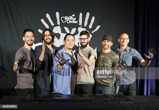 Linkin Park attend the hand induction ceremony into Guitar Center's RockWalk on June 18 2014 in Hollywood California