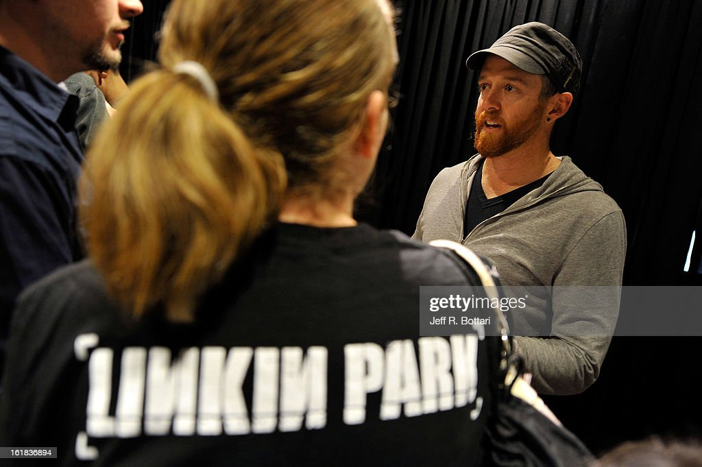 Linkin Park bassist Dave 'Phoenix' Farrell signs autographs at Club Tattoo inside the Miracle Mile Shops at Planet Hollywood Resort & Casino on February 16, 2013 in Las Vegas, Nevada.