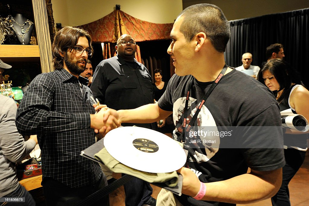 Linkin Park drummer <a gi-track='captionPersonalityLinkClicked' href=/galleries/search?phrase=Rob+Bourdon&family=editorial&specificpeople=828272 ng-click='$event.stopPropagation()'>Rob Bourdon</a> (L) signs autographs at Club Tattoo inside the Miracle Mile Shops at Planet Hollywood Resort & Casino on February 16, 2013 in Las Vegas, Nevada.