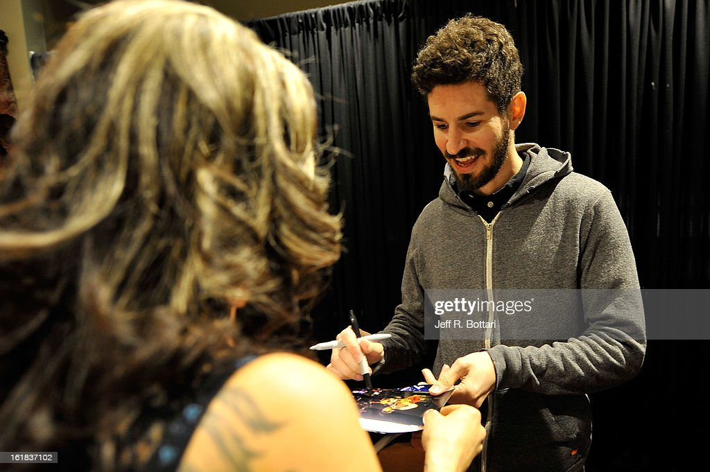 Linkin Park guitarist <a gi-track='captionPersonalityLinkClicked' href=/galleries/search?phrase=Brad+Delson&family=editorial&specificpeople=828273 ng-click='$event.stopPropagation()'>Brad Delson</a> signs autographs at Club Tattoo inside the Miracle Mile Shops at Planet Hollywood Resort & Casino on February 16, 2013 in Las Vegas, Nevada.