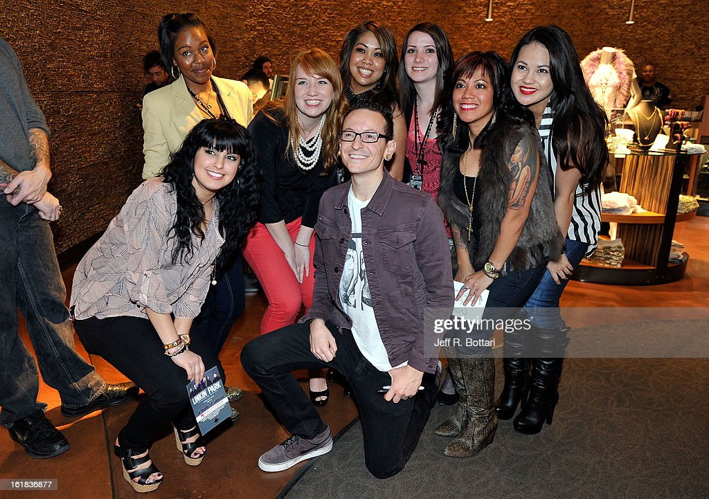 Linkin Park singer <a gi-track='captionPersonalityLinkClicked' href=/galleries/search?phrase=Chester+Bennington&family=editorial&specificpeople=213970 ng-click='$event.stopPropagation()'>Chester Bennington</a> (C) poses with fans at Club Tattoo inside the Miracle Mile Shops at Planet Hollywood Resort & Casino on February 16, 2013 in Las Vegas, Nevada.