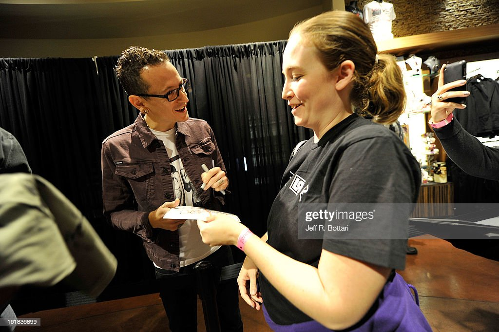 Linkin Park singer <a gi-track='captionPersonalityLinkClicked' href=/galleries/search?phrase=Chester+Bennington&family=editorial&specificpeople=213970 ng-click='$event.stopPropagation()'>Chester Bennington</a> (L) signs autographs at Club Tattoo inside the Miracle Mile Shops at Planet Hollywood Resort & Casino on February 16, 2013 in Las Vegas, Nevada.