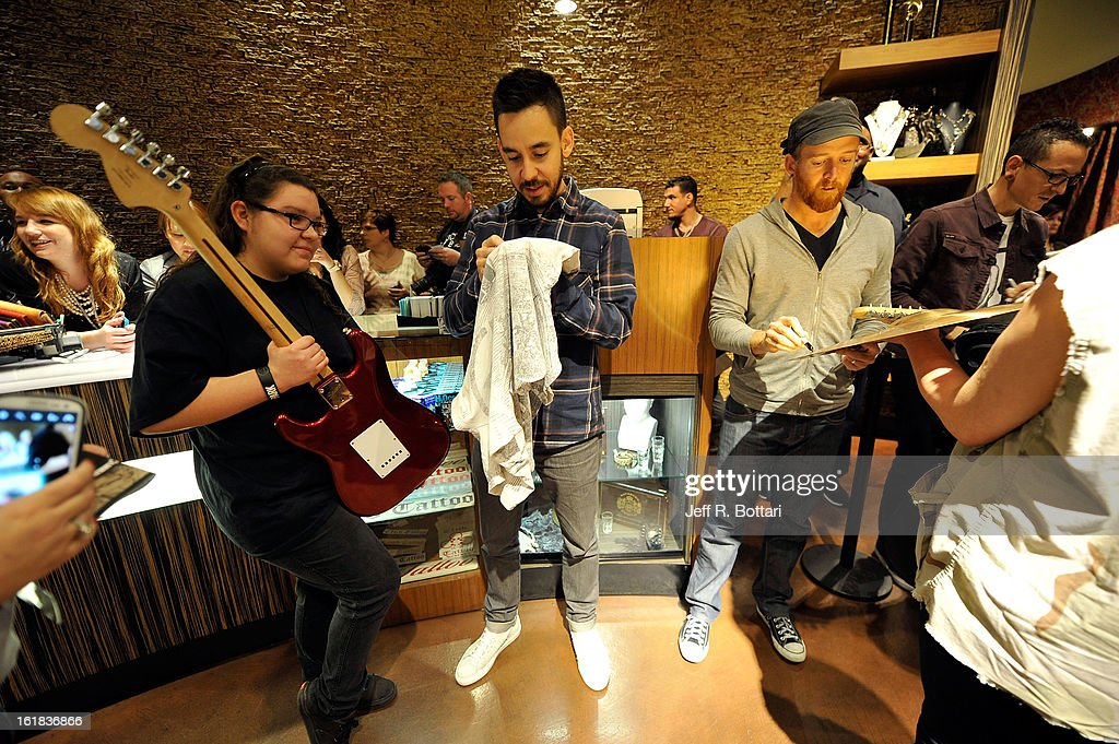 Linkin Park singer/guitarist <a gi-track='captionPersonalityLinkClicked' href=/galleries/search?phrase=Mike+Shinoda&family=editorial&specificpeople=657527 ng-click='$event.stopPropagation()'>Mike Shinoda</a>, bassist Dave 'Phoenix' Farrell and singer <a gi-track='captionPersonalityLinkClicked' href=/galleries/search?phrase=Chester+Bennington&family=editorial&specificpeople=213970 ng-click='$event.stopPropagation()'>Chester Bennington</a> sign autographs at Club Tattoo inside the Miracle Mile Shops at Planet Hollywood Resort & Casino on February 16, 2013 in Las Vegas, Nevada.
