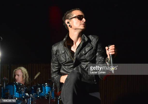 Linkin Park's Chester Bennington performs with Stone Temple Pilots during KROQ Weenie Roast Y Fiesta at Verizon Wireless Amphitheater on May 18 2013...