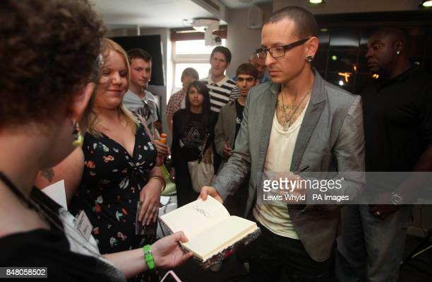Linkin Park's Chester Bennington signs autographs during a question and answer session at Absolute Radio London to mark the release of their new...