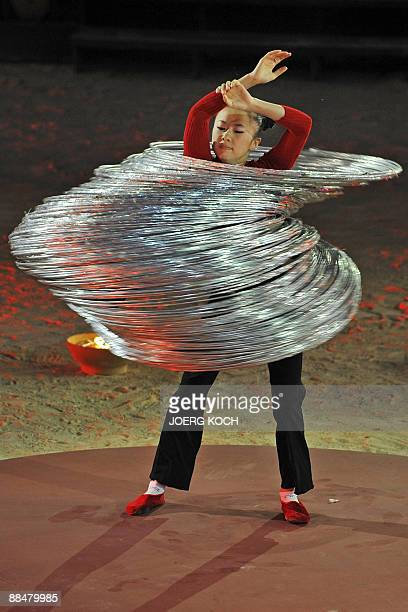 Linlin Jin from China performs with hulahoops during the German television show 'Wetten Dass' in the Spanish Island's capital Palma de Mallorca on...