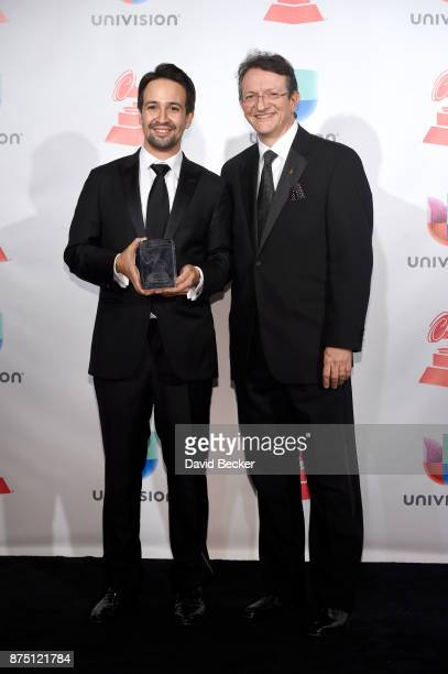 LinManuel Miranda and Latin Recording Academy President/CEO Gabriel Abaroa pose in the press room during The 18th Annual Latin Grammy Awards at MGM...