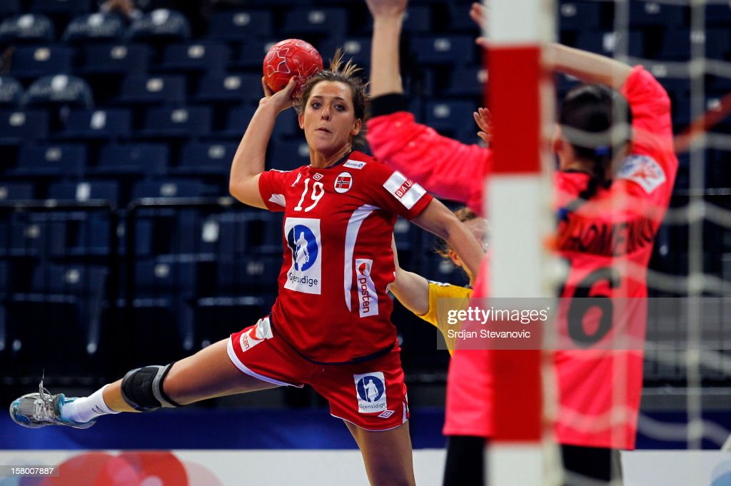 Linn Gosse (L) of Norway scores past goalkeeper Natalya Parkhomenko (R) of Ukraine during the Women's European Handball Championship 2012 Group A match between Norway and Ukraine at Arena Hall on December 08, 2012 in Belgrade, Serbia.