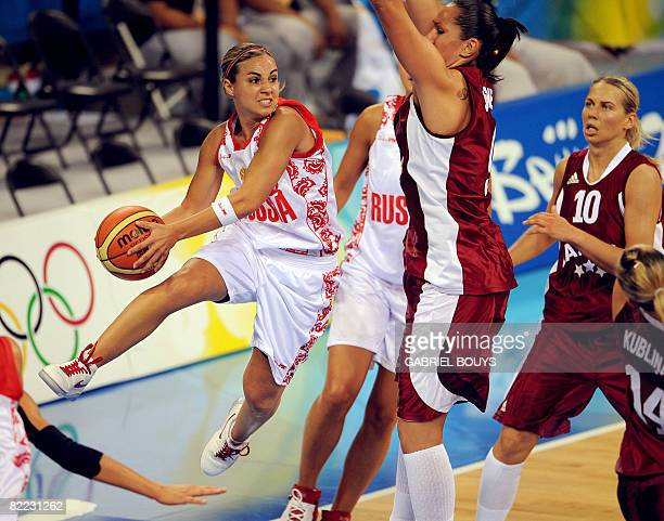 Linn Rebekka Hammon of Russia passes the ball in front of Liene Jansone of Latvia during the 2008 Beijing Olympic Games women's preliminary...