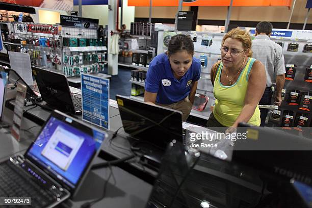 Linnette Gomez helps Lidia Ester as she shops for a computer at a Best Buy Inc's store on September 15 2009 in Miami Florida The US Commerce...