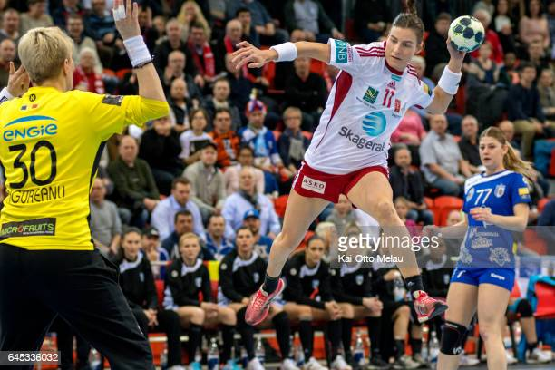 LinnKristin Riegelhuth Koren shoots on Paula Claudia Ungureanu in the Women's EHF Champions league match between Larvik HK and CSM Bucuresti on...