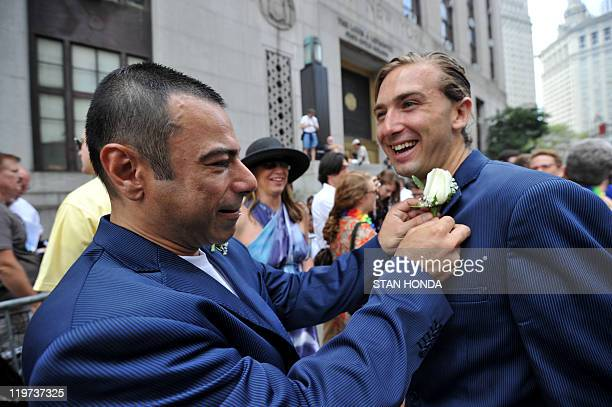 Lino Caminha Strandquist pins a flower on Daniel Luke Strandquist Caminha as they wait outside Manhattan's City Clerk's Office in order to marry July...