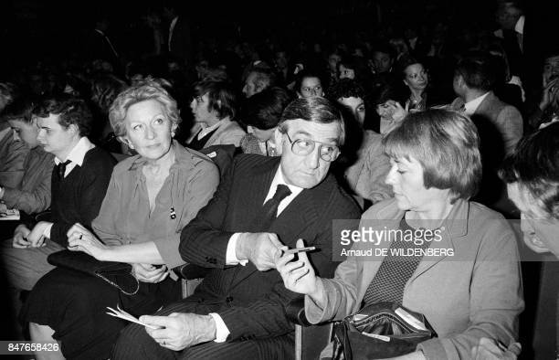 Lino Ventura with wife Odette on left and actress Annie Girardot at the Olympia music hall for the Charles Aznavour show on April 14 1980 in Paris...