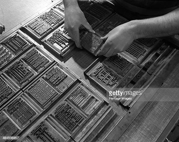 Linotype block being set in the dye at a printworks Mexborough South Yorkshire 1959 Movable type pages being set in the chase The quoins which hold...