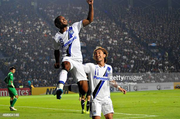 Lins Lima De Brito of Gamba Osaka celebrates scoring his team's first goal with his team mate Shu Kurata during the Asian Champions League match...