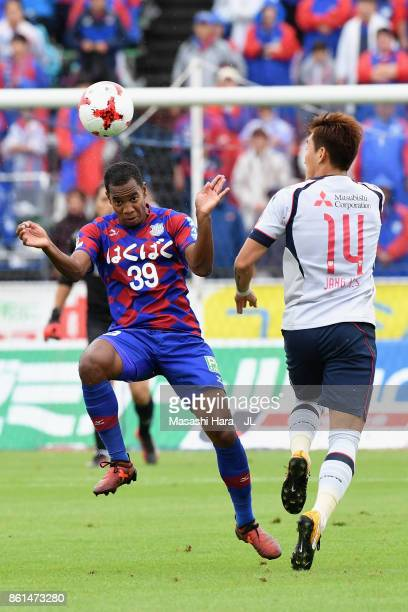 Lins of Ventforet Kofu and Jang Hyun Soo of FC Tokyo compete for the ball during the JLeague J1 match between Ventforet Kofu and FC Tokyo at...