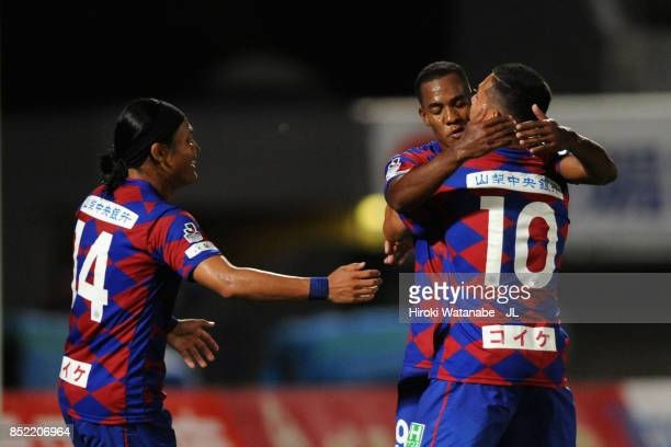 Lins of Ventforet Kofu celebrates scoring his side's third goal with his team mates Yusuke Tanaka and Dudu during the JLeague J1 match between...