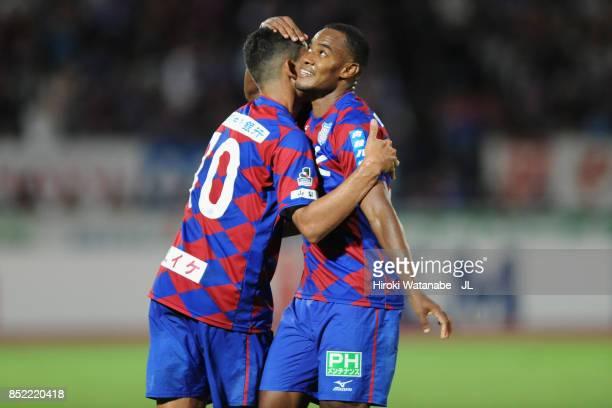 Lins of Ventforet Kofu celebrates scoring his side's third goal with his team mate Dudu of Ventforet Kofu during the JLeague J1 match between...