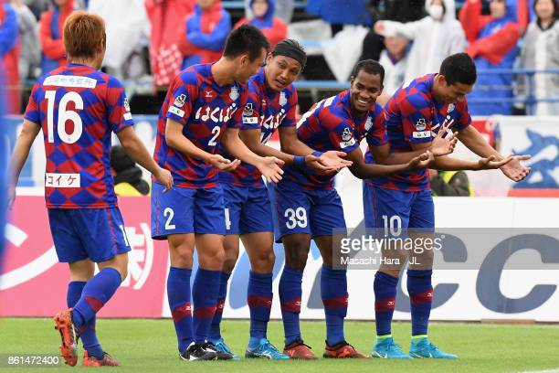 Lins of Ventforet Kofu celebrates scoring the opening goal with his team mates during the JLeague J1 match between Ventforet Kofu and FC Tokyo at...