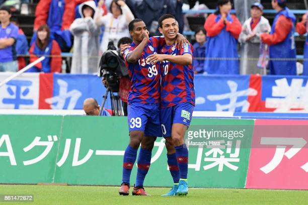 Lins of Ventforet Kofu celebrates scoring the opening goal with his team mate Dudu during the JLeague J1 match between Ventforet Kofu and FC Tokyo at...