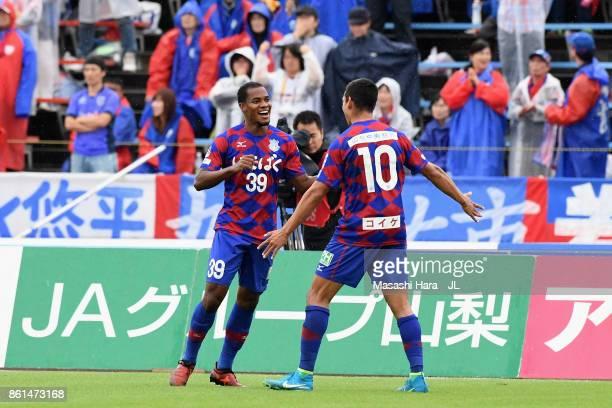 Lins of Ventforet Kofu celebrates scoring the opening goal with his team mate Dudu during the JLeague J1 match between Ventforet Kofu and FC Tokyo at...