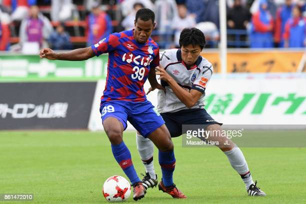 Lins of Ventforet Kofu controls the ball under pressure of Yuichi Maruyama of FC Tokyo during the JLeague J1 match between Ventforet Kofu and FC...
