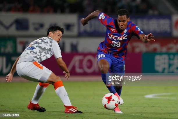 Lins of Ventforet Kofu runs past Mitsunari Musaka of Shimizu SPulse during the JLeague J1 match between Ventforet Kofu and Shimizu SPulse at...