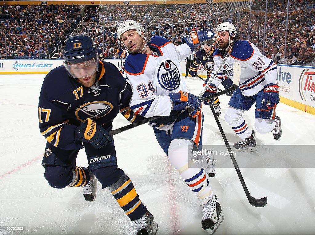 <a gi-track='captionPersonalityLinkClicked' href=/galleries/search?phrase=Linus+Omark&family=editorial&specificpeople=2086497 ng-click='$event.stopPropagation()'>Linus Omark</a> #17 of the Buffalo Sabres battles for position along the boards as Ryan Smith #94 of the Edmonton Oilers takes hold of his stick during the third period at First Niagara Center on February 3, 2014 in Buffalo, New York. Edmonton Oilers defeated the Buffalo Sabres 3-2.