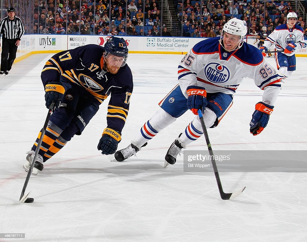 <a gi-track='captionPersonalityLinkClicked' href=/galleries/search?phrase=Linus+Omark&family=editorial&specificpeople=2086497 ng-click='$event.stopPropagation()'>Linus Omark</a> #17 of the Buffalo Sabres skates with the puck against Martin Marincin #85 of the Edmonton Oilers on February 3, 2014 at the First Niagara Center in Buffalo, New York. Edmonton won, 3-2.
