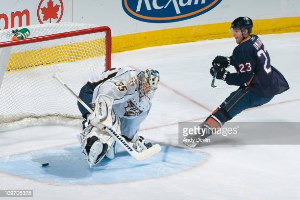 Linus Omark of the Edmonton Oilers scores the gamewinning shootout goal against Pekka Rinne of the Nashville Predators at Rexall Place on March 1...