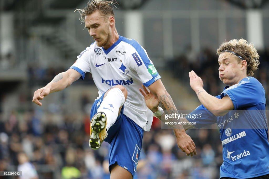 Linus Wahlqvist of IFK Norrkoping and Höskuldur Gunnlaugsson of Halmstad BK competes for the ball at Orjans Vall on September 23, 2017 in Halmstad, Sweden.