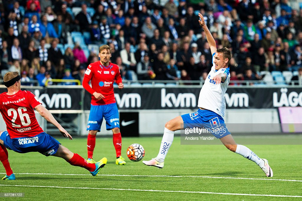 Linus Wahlqvist of IFK Norrkoping and Peter Larsson of Helsingborgs IF competes for the ball during the Allsvenskan match between IFK Norrkoping and Helsingborgs IF at Ostgotaporten on May 2, 2016 in Norrkoping, Sweden.