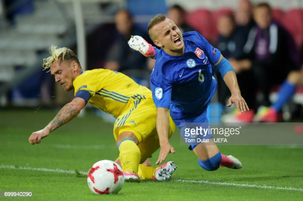 Linus Wahlqvist of Sweden fouls Stanislav Lobotka of Slovakia during the UEFA European Under21 Championship Group A match between Slovakia and Sweden...