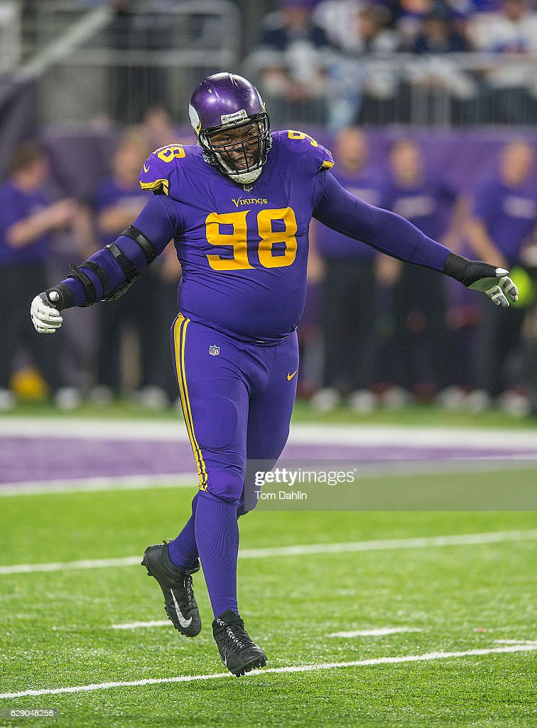 ... Stitched Snapback Adjustable Player Hat - PurpleGold Linval Joseph 98  of the Minnesota Vikings celebrates during an NFL game against the Dallas  ... d7b921ef5