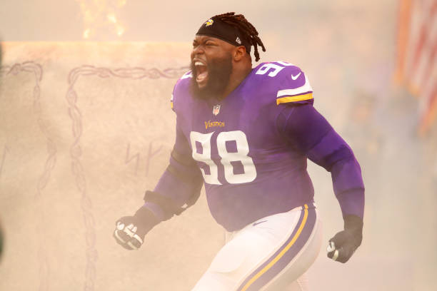 f03411cbf ... Linval Joseph 98 of the Minnesota Vikings runs on field during  introductions of the game .