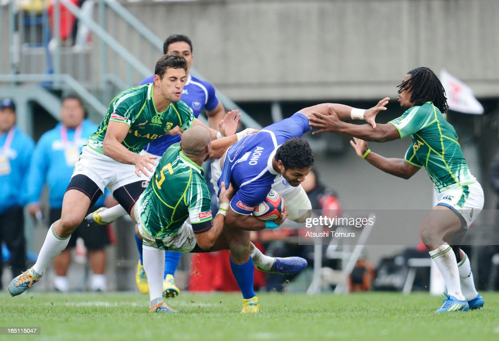 Lio Lolo of Samoa breaks the tackle of Cornal Hendricks of South Africa during the match against South Africa on day two of the HSBC Sevens Tokyo at Prince Chichibu Stadium on March 31, 2013 in Tokyo, Japan.