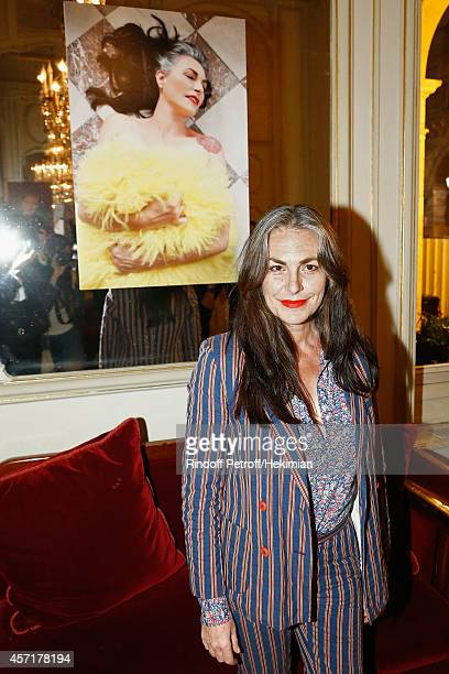 Lio poses next to her picture during the Nathalie Garcon's Book Signing Cocktail Party At Hotel Regina on October 13 2014 in Paris France
