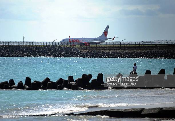 A Lion Air airplane prepares to take off at Ngurah Rai airport in Denpasar on Bali island on February 16 2012 Indonesia's fast growing Lion Air which...