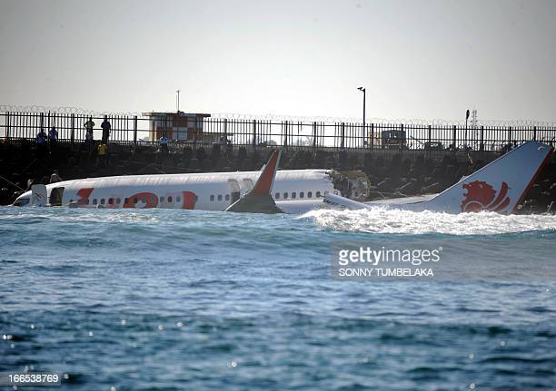 A Lion Air Boeing 737 lies submerged in the water after missing the runaway during landing at Bali's international airport near Denpasar on April 14...