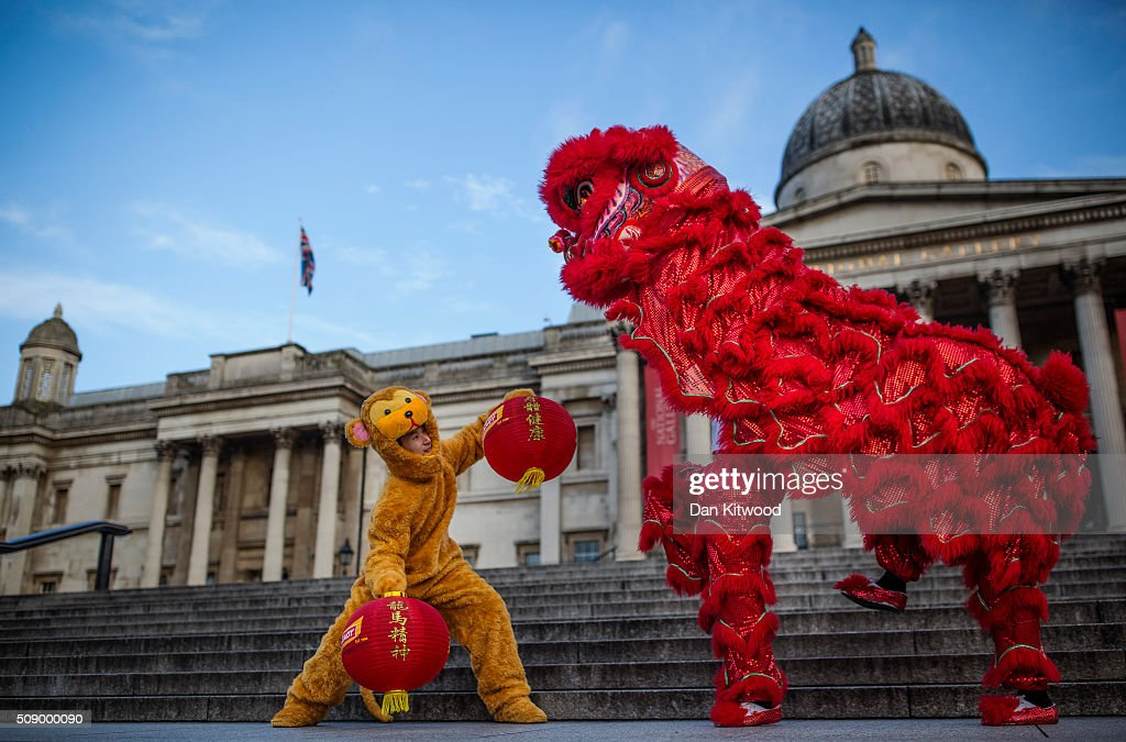 A Lion and a Monkey dance on the steps of Trafalgar Square during a Chinese New Year photocall on February 8, 2016 in London, England. The Year of the Monkey begins on February 8 and will last until Jan 27, 2017.