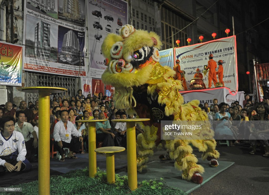 A Lion dance dancer performs during the lion dance competition in celebration of the Chinese new year in Yangon on February 14, 2013. AFP PHOTO/ Soe Than WIN