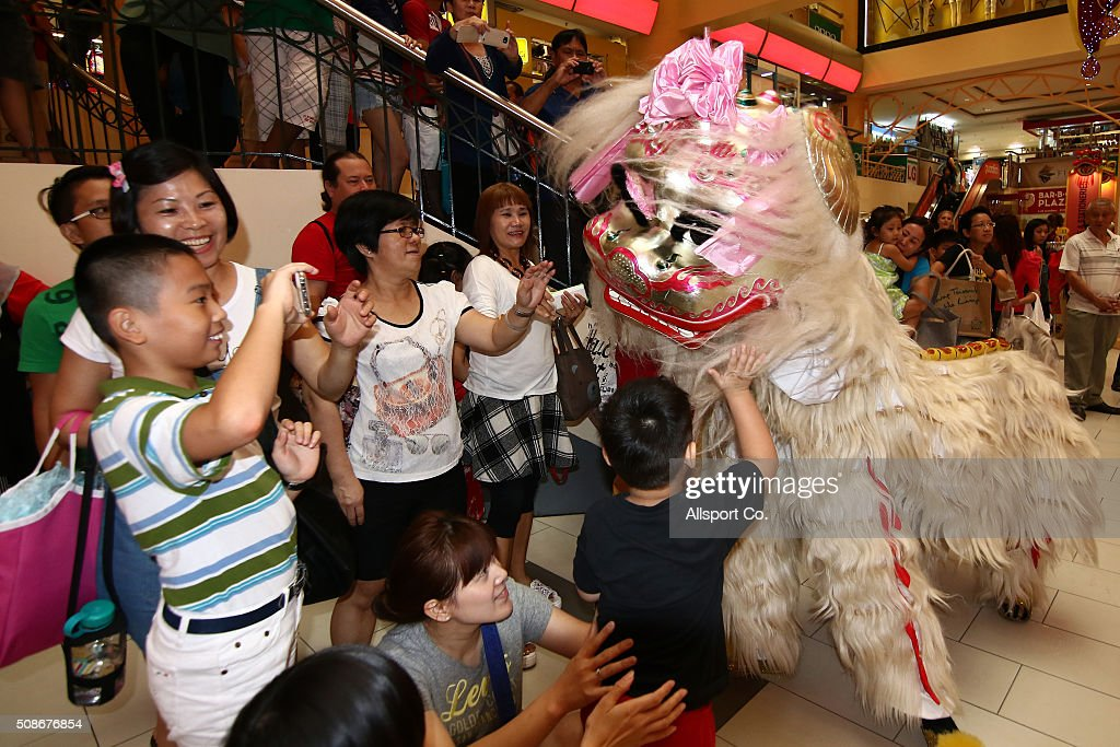 A Lion Dance greets people in a shopping mall ahead of Lunar New Year of the monkey celebrations on February 6, 2016 in Kuala Lumpur, Malaysia. According to the Chinese Calendar, the Lunar New Year which falls on February 8 this year marks the Year of the Monkey, the Chinese Lunar New Year also known as the Spring Festival is celebrated from the first day of the first month of the lunar year and ends with Lantern Festival on the Fifteenth day.