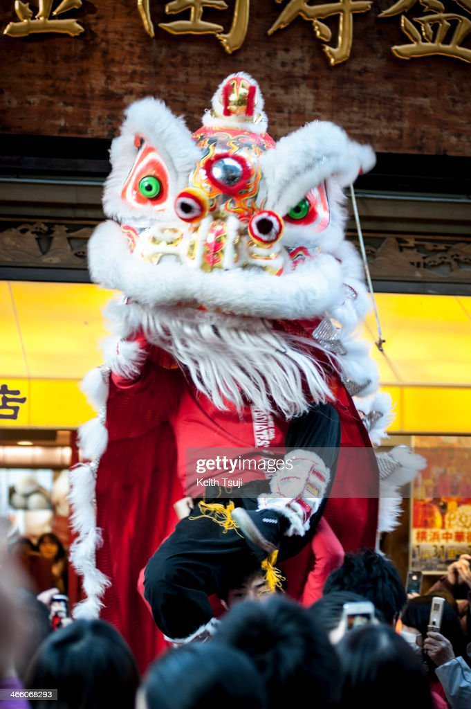 A lion dance is performed in front of the Chinese restaurant in the Yokohama China Town on January 31, 2014 in Yokohama, Japan. It's the Lunar New Year and Year of the Horse, Chinese New Year is an important traditional Chinese holiday and it is celebrated worldwide within Chinese community.